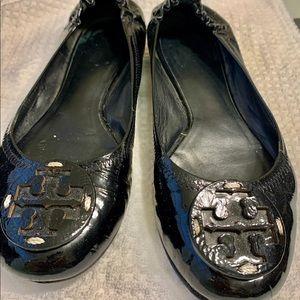 The classic Tory  Burch Reva Black Patent leather